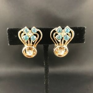 Vintage gold clip earrings with light blue stones